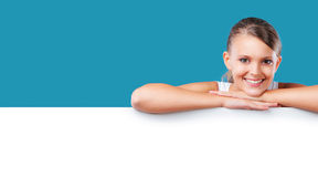 Smiling blonde woman lying on copyspace Stock Images