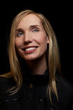 Smiling blonde woman at night stock photo