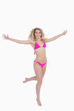Smiling blonde woman opening her arms Stock Images