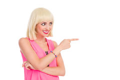 Smiling blonde woman pointing Stock Photography