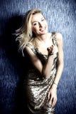 Smiling blonde woman posing. Royalty Free Stock Image