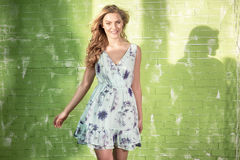 Smiling blonde woman posing. royalty free stock images