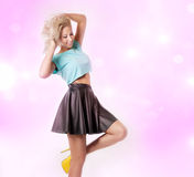 Smiling blonde woman posing. Royalty Free Stock Photography