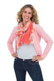 Smiling blonde woman posing with hands on hips Royalty Free Stock Photo