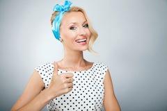 Smiling blonde woman posing Stock Photo