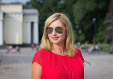 Smiling blonde woman in sunglasses Royalty Free Stock Image