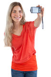 Smiling blonde woman taking picture of herself Royalty Free Stock Image