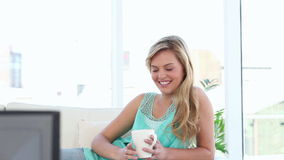 Smiling blonde woman watching the television stock video