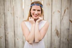 Smiling blonde woman wearing headband Stock Photo