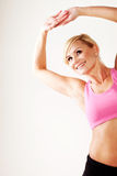 Smiling blonde woman working out Royalty Free Stock Photo