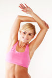 Smiling blonde woman working out Stock Photo