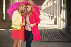 Smiling blonde women with the colorful umbrellas Royalty Free Stock Photo