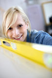 Smiling blong woman with level Stock Photos