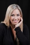 Smiling bloung blond girl in black Royalty Free Stock Images