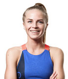 Smiling Blue eyed blond girl. With teeth tail hair in sportswear with crossed arms and front standing on white isolated background Stock Photography