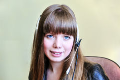Smiling blue-eyed girl operator Royalty Free Stock Images