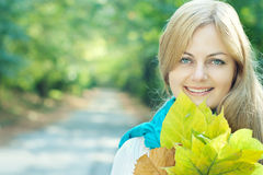 Smiling blue-eyed young woman Royalty Free Stock Image