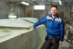 Smiling Boat Repairman Posing in Workshop royalty free stock photography