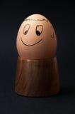 Smiling boiled egg on the wooden egg holder Stock Photography