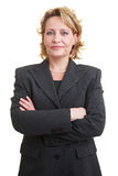 Smiling boss. Business woman in jacket with crossed arms stock images
