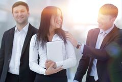 Boss and business team in office. Smiling boss and business team Stock Photos