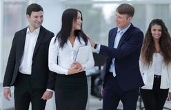 Boss and business team in office. Smiling boss and business team Royalty Free Stock Images