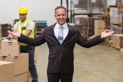 Smiling boss with hands out Royalty Free Stock Image