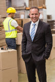 Smiling boss standing with hands in pockets Royalty Free Stock Photo