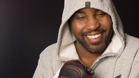 Smiling Male Boxer Wearing Hoodie Works Out Royalty Free Stock Photo