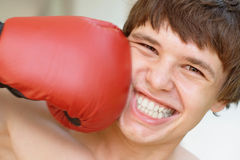 Smiling boxer gets a punch Royalty Free Stock Image