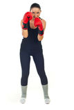 Smiling boxer woman defending Royalty Free Stock Image
