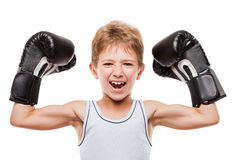 Smiling boxing champion boy gesturing for victory triumph. Martial art sport success and win concept - smiling boxing champion child boy gesturing for first Stock Photo