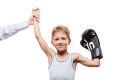 Smiling boxing champion child boy gesturing for victory triumph. Martial art sport success and win concept - smiling boxing champion child boy gesturing for Stock Photos