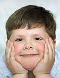 The smiling boy. The little boy happily smiling Royalty Free Stock Photography