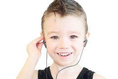Smiling boy. Little boy listening music and smiling; on white background Royalty Free Stock Image