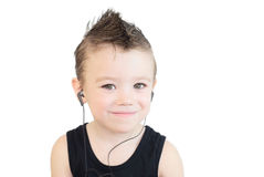 Smiling boy. Little boy listening music and smiling; on white background Stock Photo