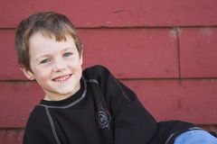 Smiling Boy. A smiling boy and red barn background Stock Photography