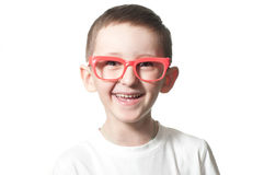 Smiling boy. Happy boy with red glasses smiling, portrait Royalty Free Stock Image