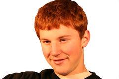 Smiling Boy. Red headed smiling teenage boy portrait stock image
