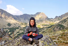 Smiling boy. A portrait with happy boy eating chocolate on the mountain Royalty Free Stock Photos