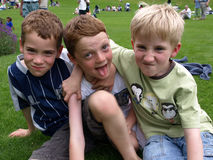 Smiling Boy. A photograph of three boys playing in summer stock images