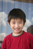 Smiling boy. Little Chinese boy in red tee smiling happily Stock Image