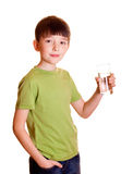 Smiling boy. With a glass of water Stock Photos