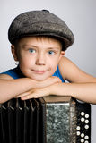 Smiling boy with accordion Royalty Free Stock Photo