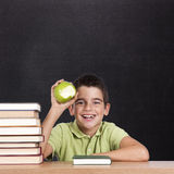 Smiling boy with apple Royalty Free Stock Photo