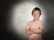 Smiling boy with arms crossed Royalty Free Stock Photos