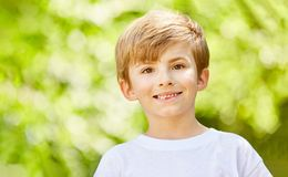 Smiling boy as a birthday child. Or in summer vacations Stock Images