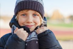 Smiling boy in autumn day Royalty Free Stock Photos