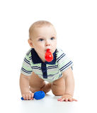 Smiling boy baby  with musical toys.  on white background Royalty Free Stock Photo