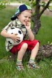 Smiling boy with balloon Stock Photos